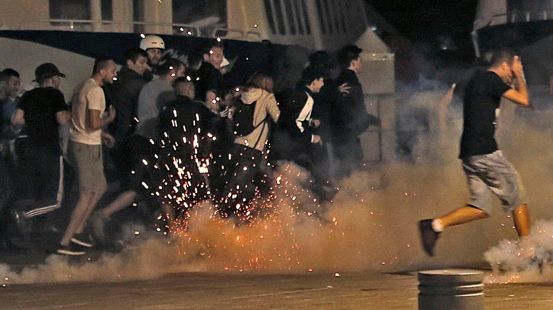 Police disperse revellers at the old port of Marseille after the England v Russia - Group B match. (Reuters)