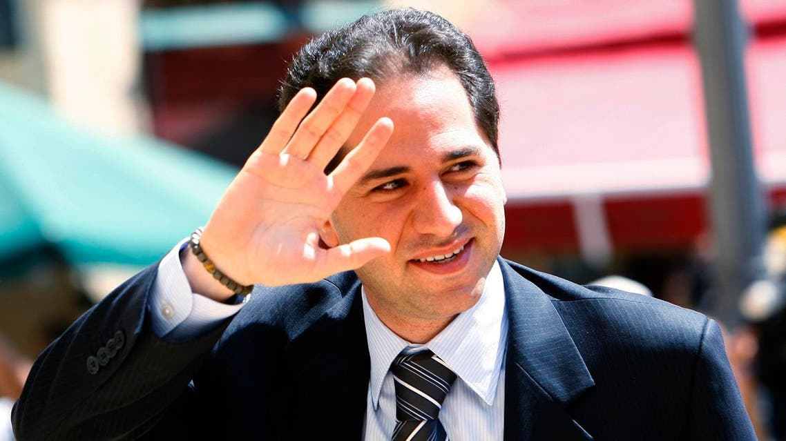 In this June 25, 2009, file photo, Lebanese lawmaker Sami Gemayel, son of former President Amin Gemayel and brother of Pierre Gemayel, an industry minister gunned down in 2006, gestures as he arrives at the Parliament for the election of the house speaker in Beirut, Lebanon. To the casual visitor, Lebanon may look like a relative success story: a tiny slice of modernity and coexistence in a turbulent region plagued by violence and extremism _ but the reality is quite different. For residents, it's a failed state eaten away by a sectarian political class, and while recent trash protests have challenged that system, others argue it's what's allowed a country of 4.5 million people from 18 recognized sects to survive. (AP)