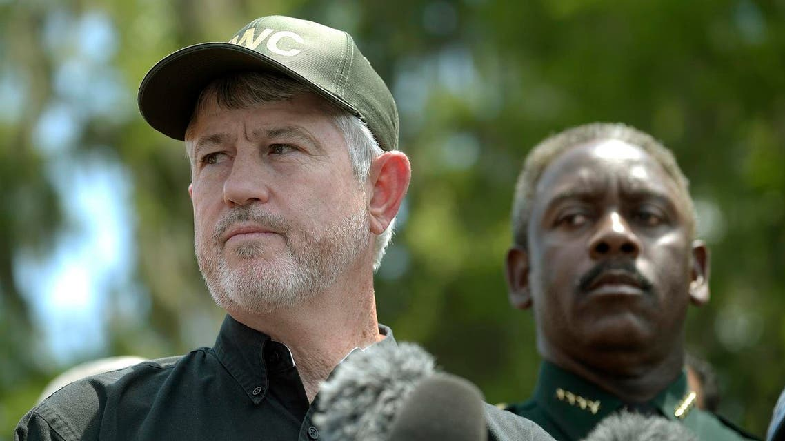 Nick Wiley, executive director of the Florida Fish & Wildlife Conservation Commission, left, and Orange County Sheriff Jerry Demings answer questions from reporters. (AP)