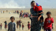 Why do some Yazidi girls held captive by ISIS choose not to return home?