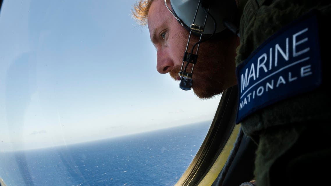 This handout picture taken on May 22, 2016 and released by the French Navy (Marine Nationale) on May 23, 2016, shows a French solider aboard an aircraft looking out a window during searches for debris from the crashed EgyptAir flight MS804. (AFP)
