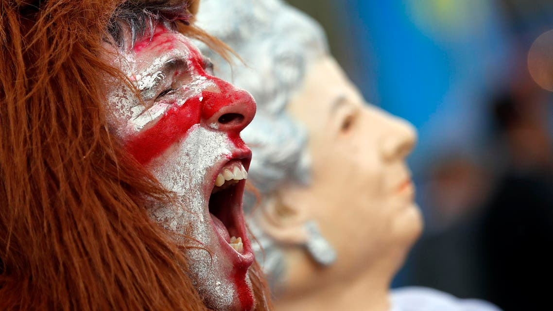 England supporters celebrate their 2-1 win at the end of the Euro 2016 Group B soccer match between England and Wales, in Bordeaux's fan zone, France, Thursday, June 16, 2016. (AP)