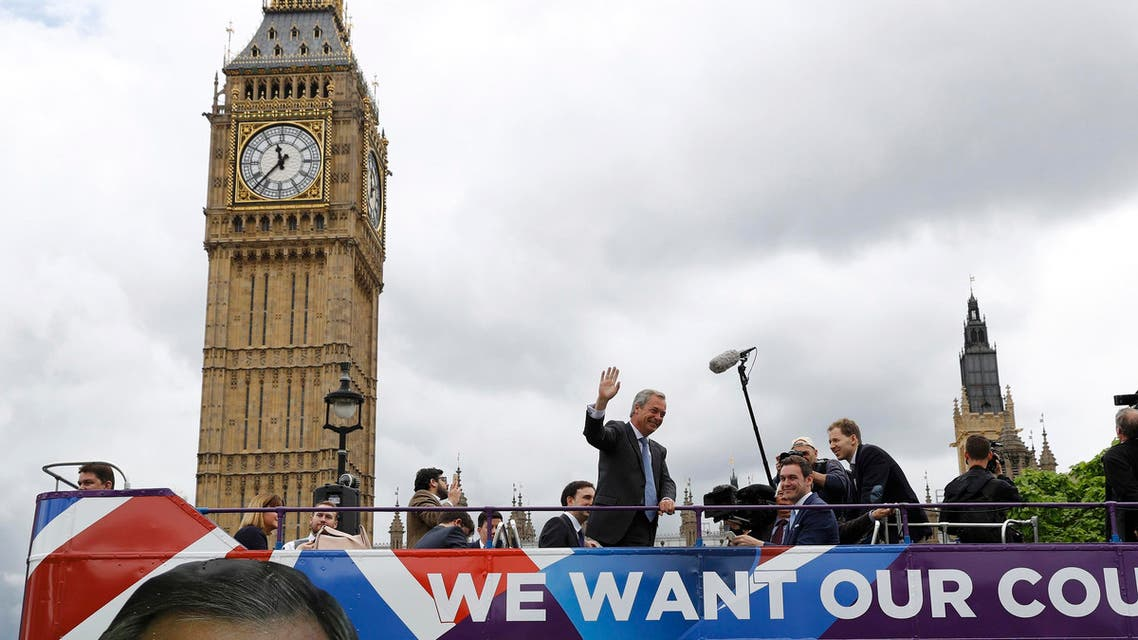 Leader of the United Kingdom Independence Party (UKIP) Nigel Farage waves a launch for an EU referendum poster from a bus at Parliament Square in London, Britain June 16, 2016. REUTERS
