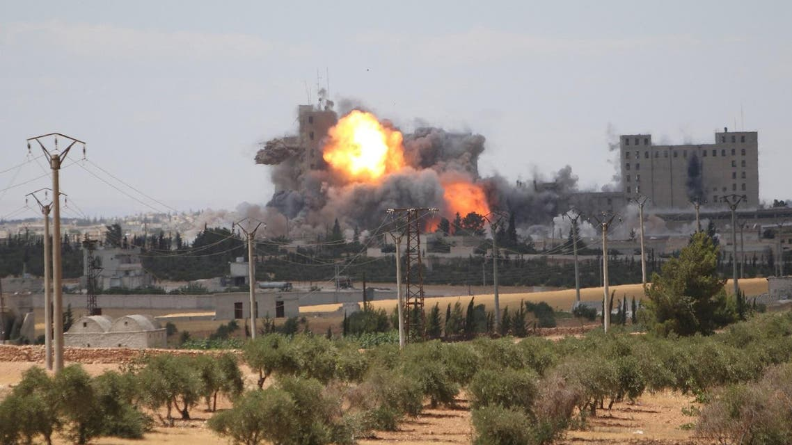 Smoke and flame rise after what fighters of the Syria Democratic Forces (SDF) said were U.S.-led air strikes on the mills of Manbij where Islamic State militants are positioned, in Aleppo Governorate. (Reuters)