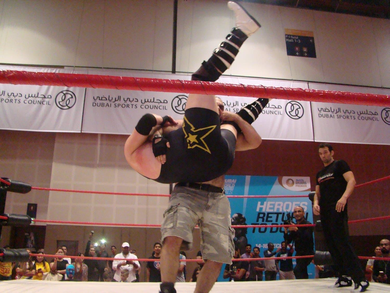 Savage Sam hurls Rich n Famous to the floor. (Tarek Ali Ahmad, Al Arabiya English)
