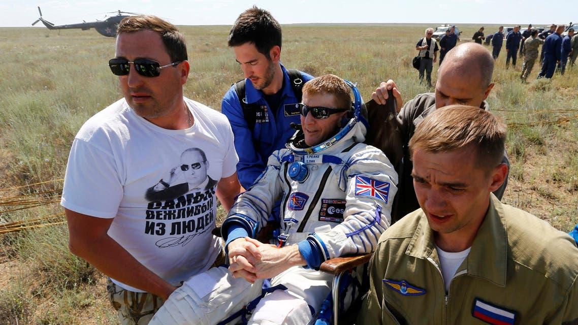 Ground personnel carry International Space Station (ISS) crew member Timothy Peake of Britain shortly after landing near the town of Dzhezkazgan (Zhezkazgan), Kazakhstan, June 18, 2016. REUTERS