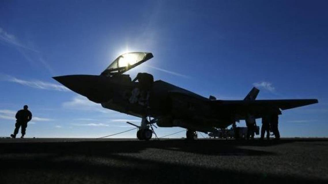A Lockheed Martin Corp's F-35C Joint Strike Fighter is shown on the deck of the USS Nimitz aircraft carrier after making the plane's first ever carrier landing using its tailhook system, off the coast of California, November 3, 2014