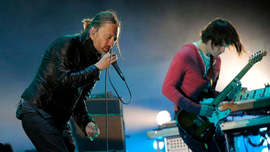 """In this April 14, 2012 file photo, Thom Yorke, left, and Jonny Greenwood of Radiohead perform during the band's headlining set at the 2012 Coachella Valley Music and Arts Festival in Indio, Calif. Radiohead's ninth studio album """"A Moon Shaped Pool"""" is now available to purchase on iTunes and Amazon and stream on Tidal and Apple Music. The groundbreaking rock group released two songs, """"Burn the Witch"""" and """"Daydreaming,"""" online earlier in the week in a lead-up to the 11-track album's release Sunday, May 8, 2016. (AP Photo/Chris Pizzello, File)"""