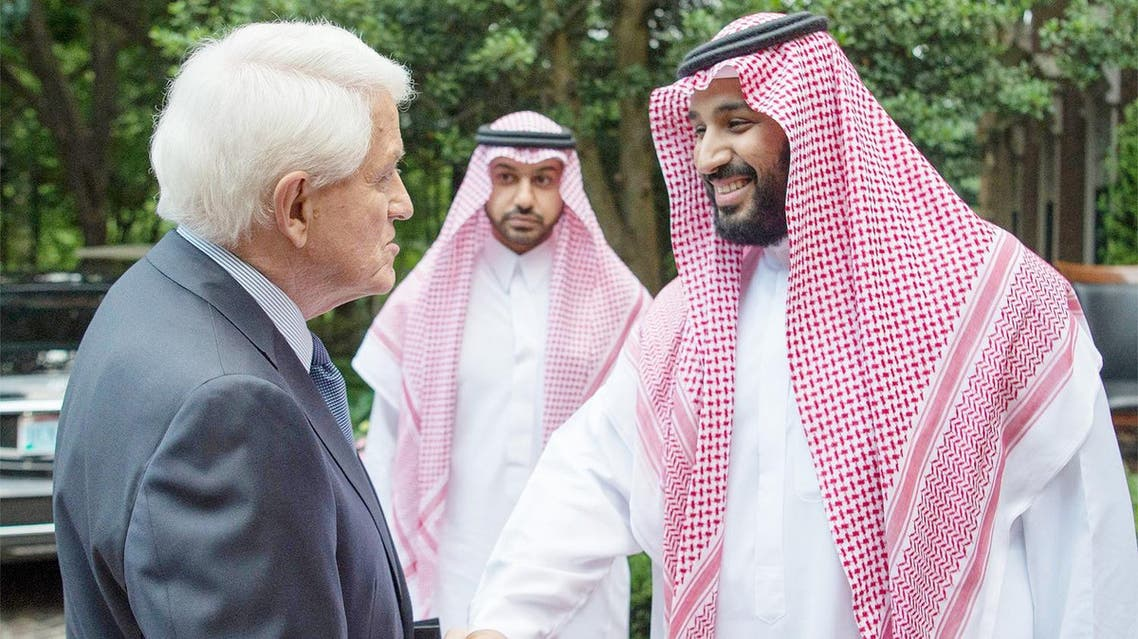 Prince Muhammad shakes hands with Thomas Donohue, president of the US Chamber of Commerce, in Washington. They reviewed several topics related to trade and investment between the two countries and discussed ways of enhancing them. (Saudi Gazette)