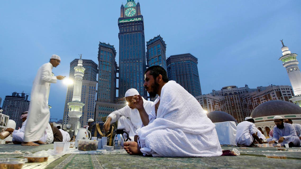 Worshippers eat during Iftar, or breaking of the fast, at the Grand Mosque in the holy city of Makkah, Saudi Arabia, Wednesday, July 10, 2013. (Reuters)