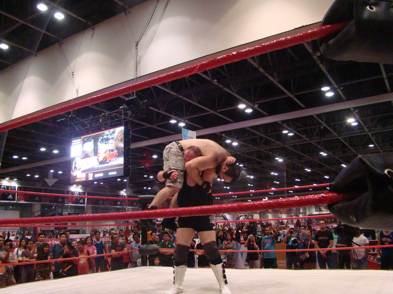 Rich n Famous carries Savage Sam preparing to beat him down. (Tarek Ali Ahmad, Al Arabiya English)
