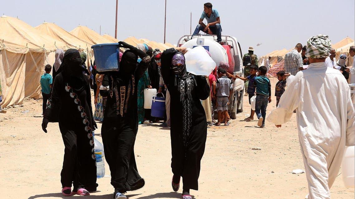 Internally displaced Iraqis at a camp outside Fallujah, Iraq, Monday, June 14, 2016. AP