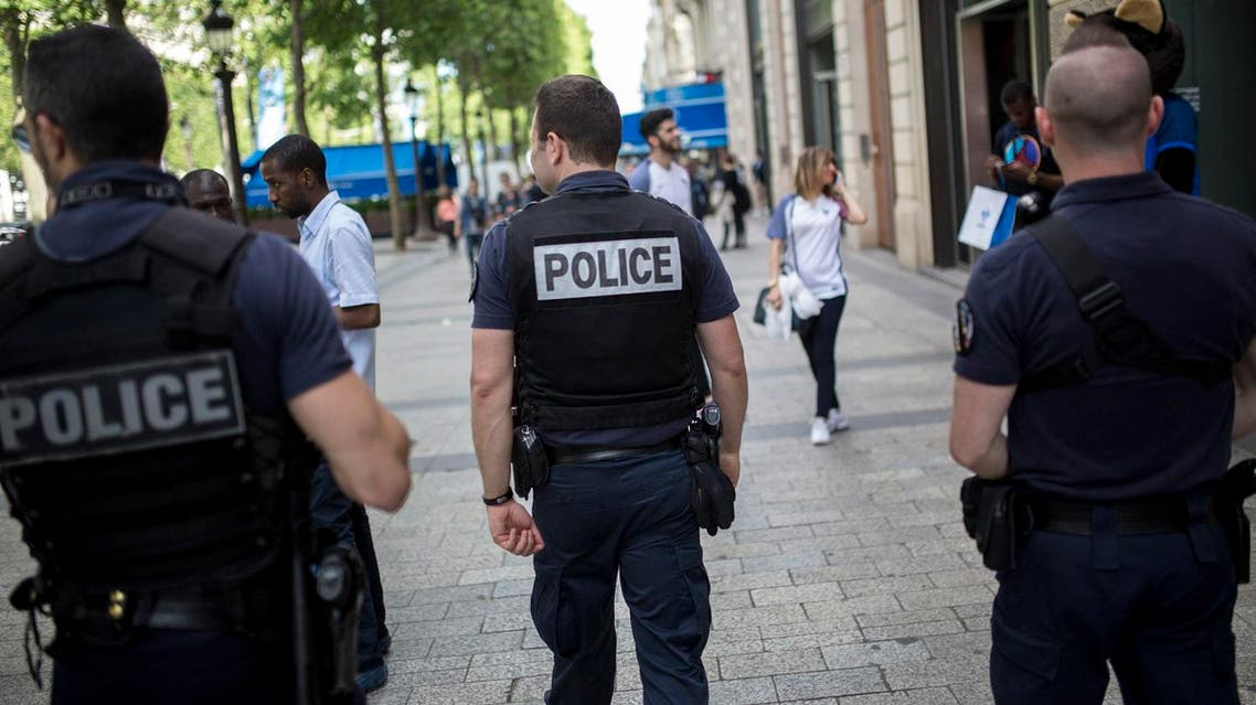 French police officers patrol on the Champs Elysees in Paris, Wednesday, June 15, 2016. French authorities are on especially high alert around the European Championship soccer tournament taking place across the country through July 10. (AP)