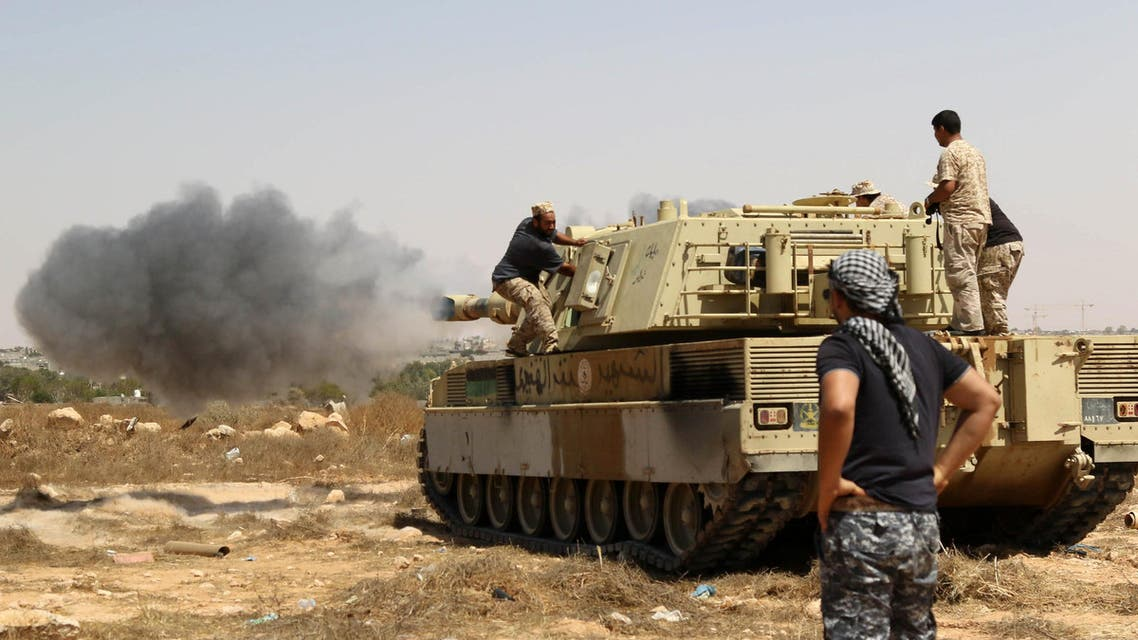 Forces loyal to Libya's UN-backed unity government fire from a tank in Sirte's centre towards Ouagadougou as they advance to recapture the city from the Islamic State (IS) group jihadists on June 10, 2016. (AFP)