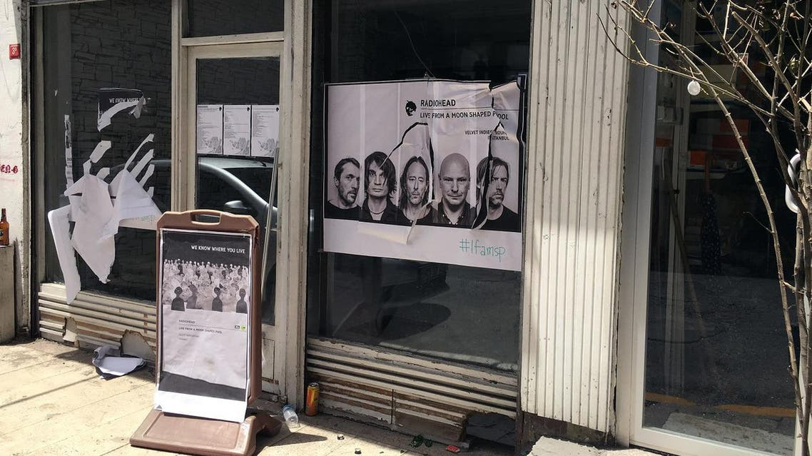 A ripped up poster advertising the streaming event of Radiohead's new album, at a record shop, in Istanbul, Saturday, June 18, 2016. (AP)