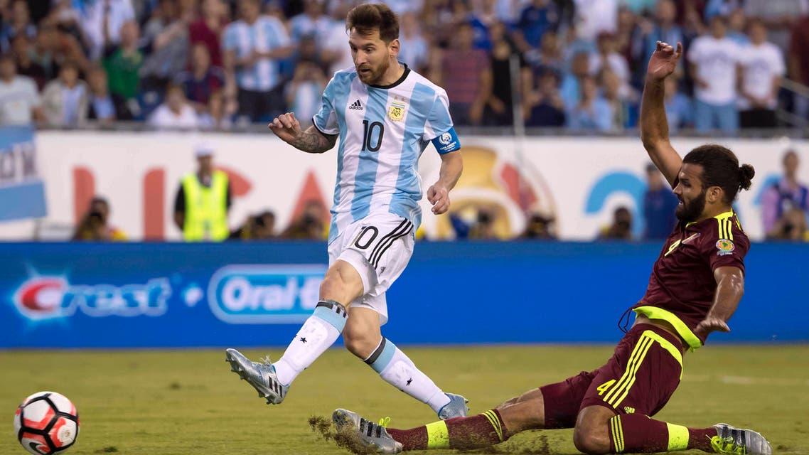 Lionel Messi scores a goal past Venezuela defender Oswaldo Vizcarrondo during the Copa America quarter-final play. (Reuters)