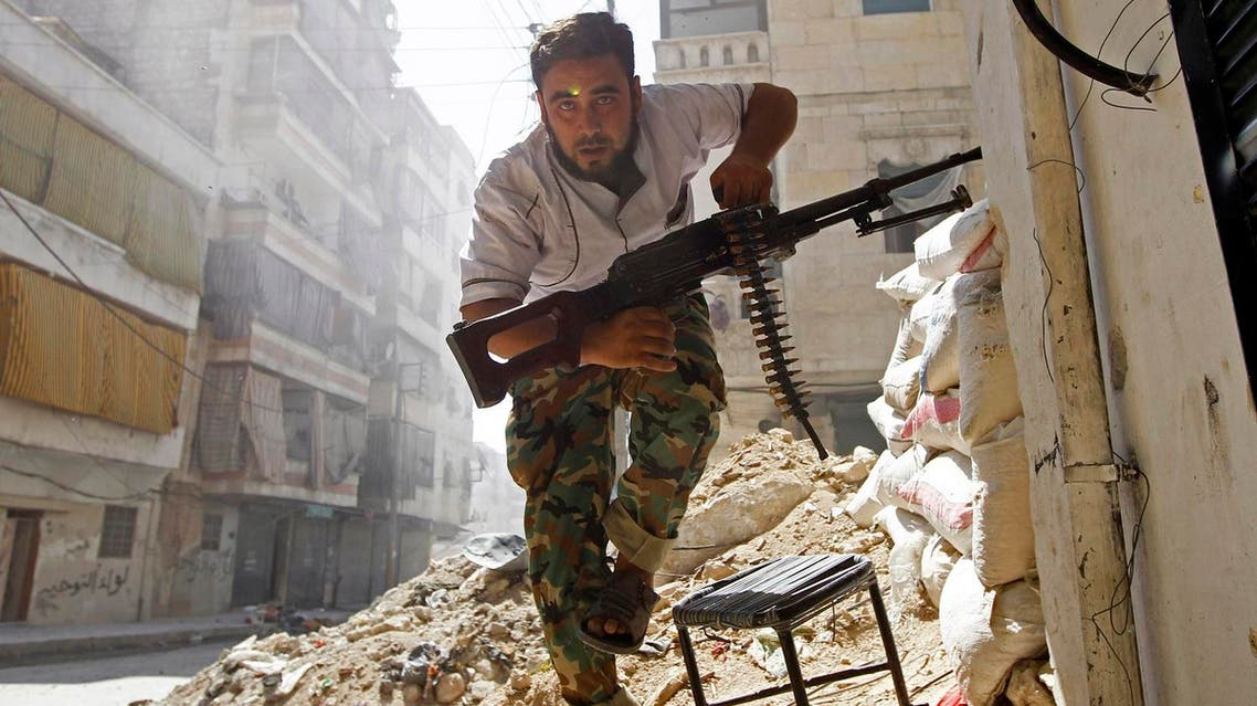 A Free Syrian Army fighter takes cover during clashes with Syrian Army in the Salaheddine neighbourhood of central Aleppo August 7, 2012. REUTERS