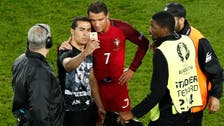 Cristiano Ronaldo takes selfie with fan after missing penalty