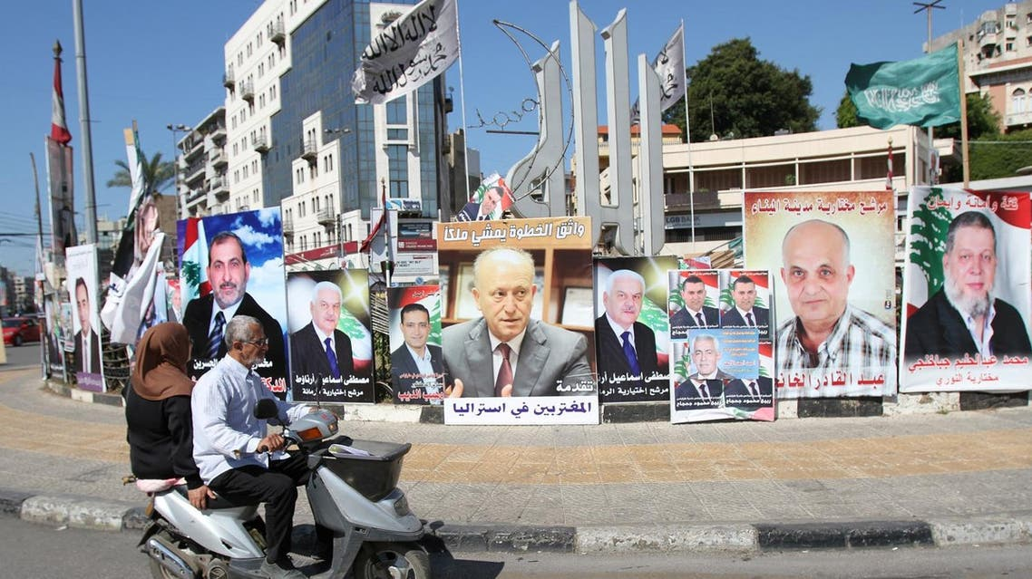 A poster depicting Sunni politician Ashraf Rifi (C) is seen among posters of Lebanese candidates that were running in Tripoli's municipal and mayoral elections, Lebanon, May 30, 2016. REUTERS