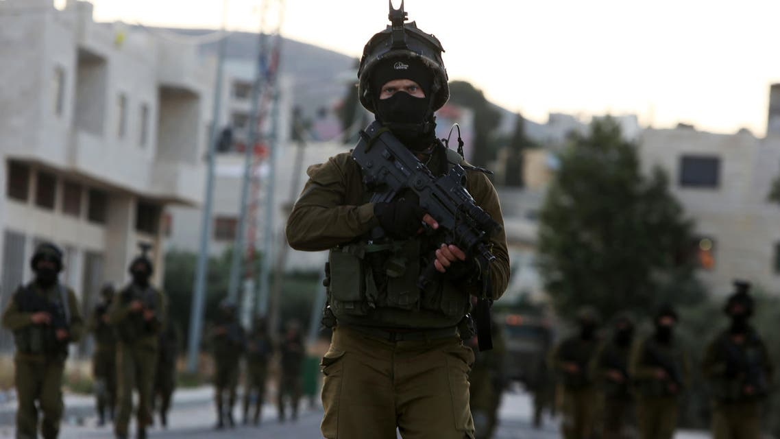 Israeli soldiers patrol a street in the northern West Bank village of Salem, east of Nablus, during an operation to arrest wanted Palestinians early on May 30, 2016. afp