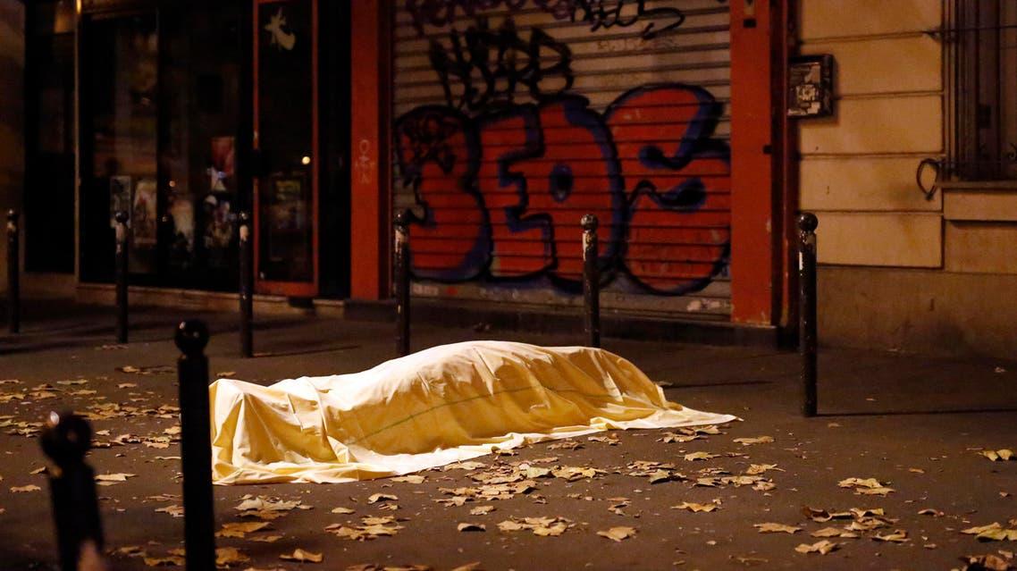 A victim of a terrorist attack lies dead outside the Bataclan theater in Paris, Nov. 13, 2015. (AP)