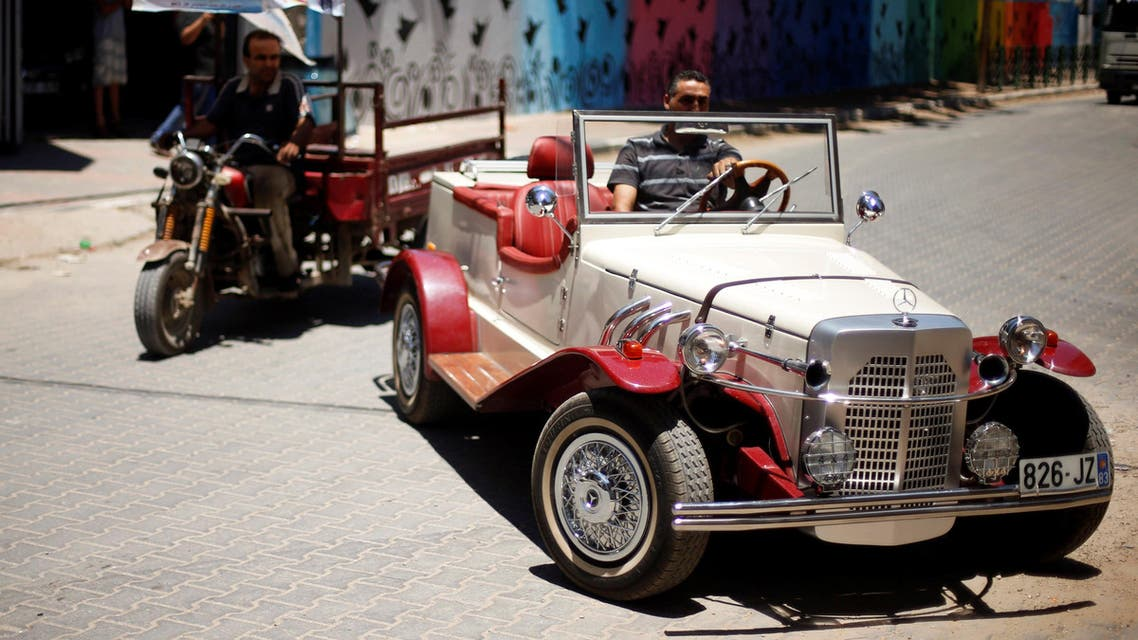 Palestinian Munir Shindi, 36, drives a replica of a 1927 Mercedes Gazelle that he built from scratch, on a street in Gaza City June 19, 2016. AP