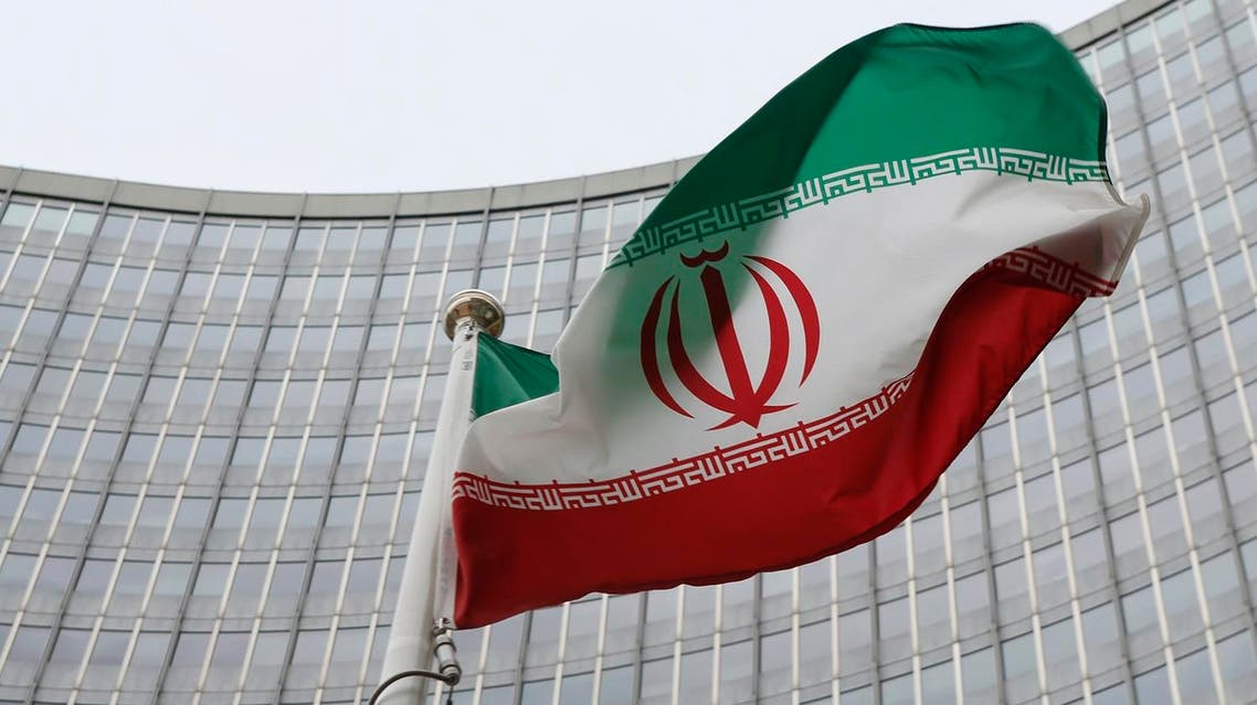 An Iranian flag flutters in front of the International Atomic Energy Agency (IAEA) headquarters in Vienna, Austria, January 15, 2016. REUTERS
