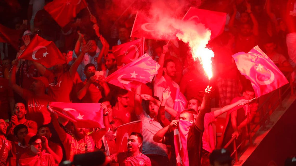 Turkey fans light a flare in the staduim during their match against Spain. (Reuters)