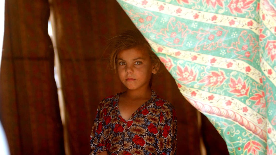 An Iraqi girl, who fled from Falluja because of Islamic State violence, poses for a photographer at a refugee camp in Ameriyat Fallujah, south of Fallujah, Iraq, June 16, 2016. (Reuters)