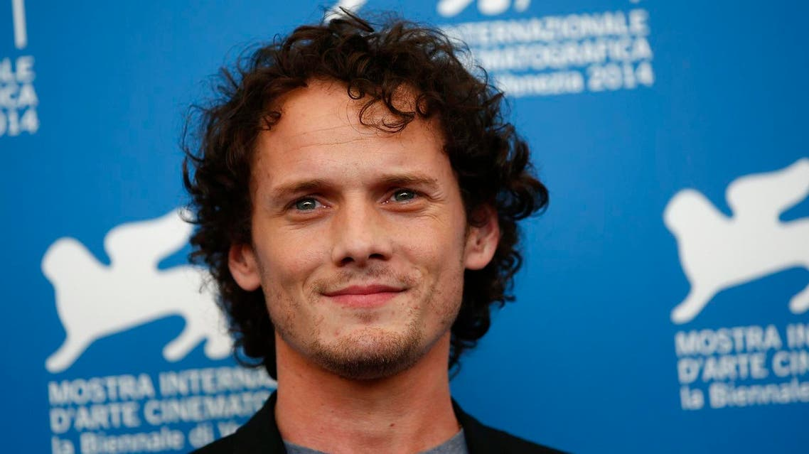 """Cast member Anton Yelchin poses during the photo call for the movie """"Burying the ex"""" at the 71st Venice Film Festival September 4, 2014. REUTERS"""