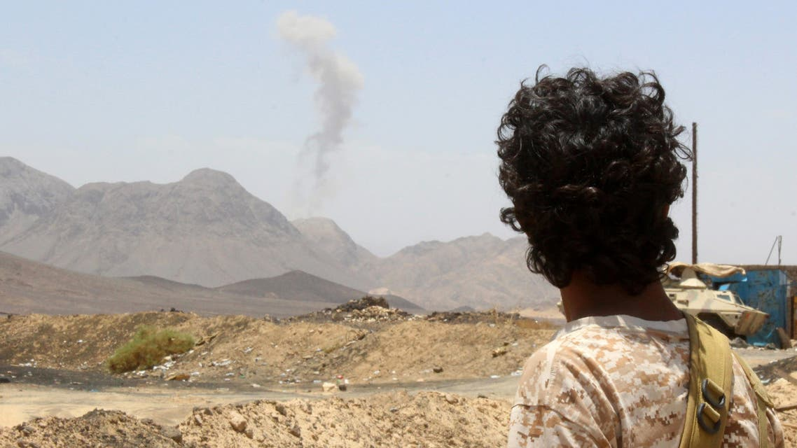 A Yemeni fighter loyal to exiled President Abedrabbo Mansour Hadi looks at smoke rising in the distance in the Sirwah area, in Marib province, on April 10, 2016, during clashes with Shiite Huthi rebels. AFP