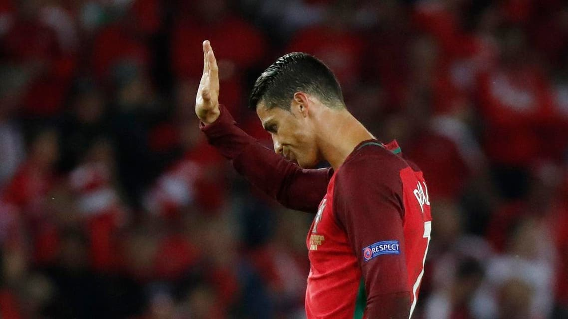 Portugal's Cristiano Ronaldo waves to fans after the game REUTERS