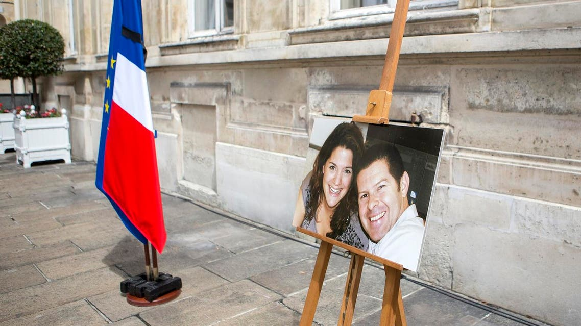 A picture taken on June 15, 2016 at the Ministry of Interior in Paris during a memorial ceremony shows a photograph of French policeman Jean-Baptiste Salvaing and his partner Jessica Schneider. (File photo: AFP)