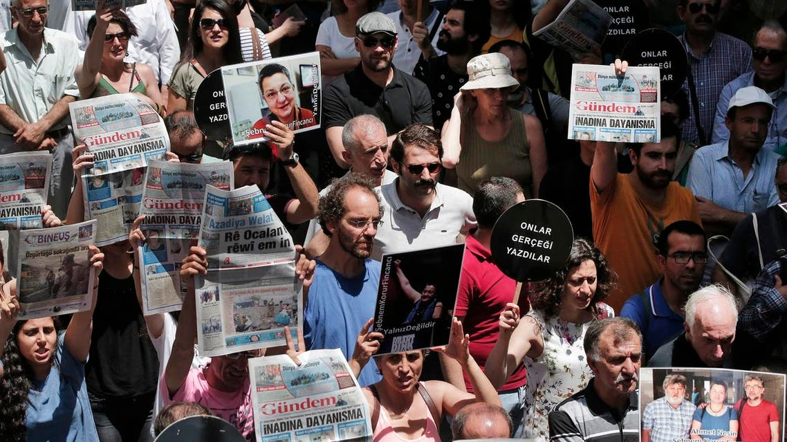 Protesters demonstrate against the jailing of two journalists and an academic, outside the offices of Ozgur Gundem, a pro-Kurdish publication, in Istanbul, Tuesday, June 21, 2016 (Photo: AP)