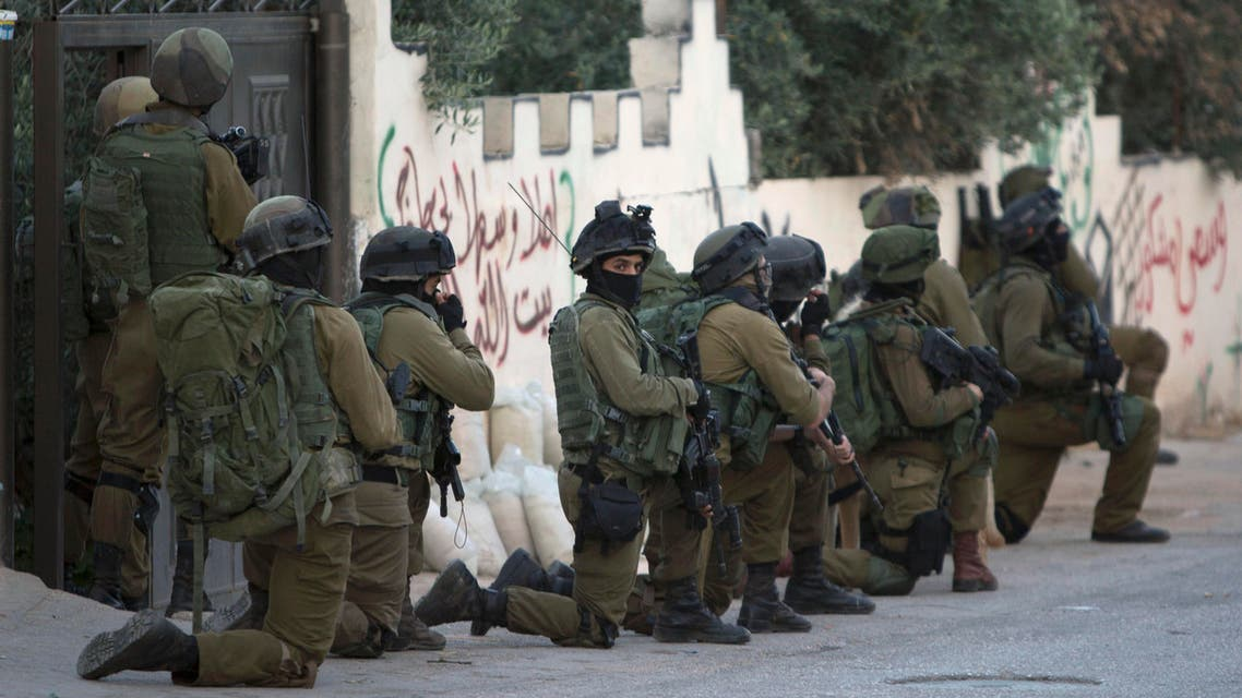 Israeli troops deploy during an army operation at West Bank village of Salem, near Nablus, Monday, May 30, 2016. AP