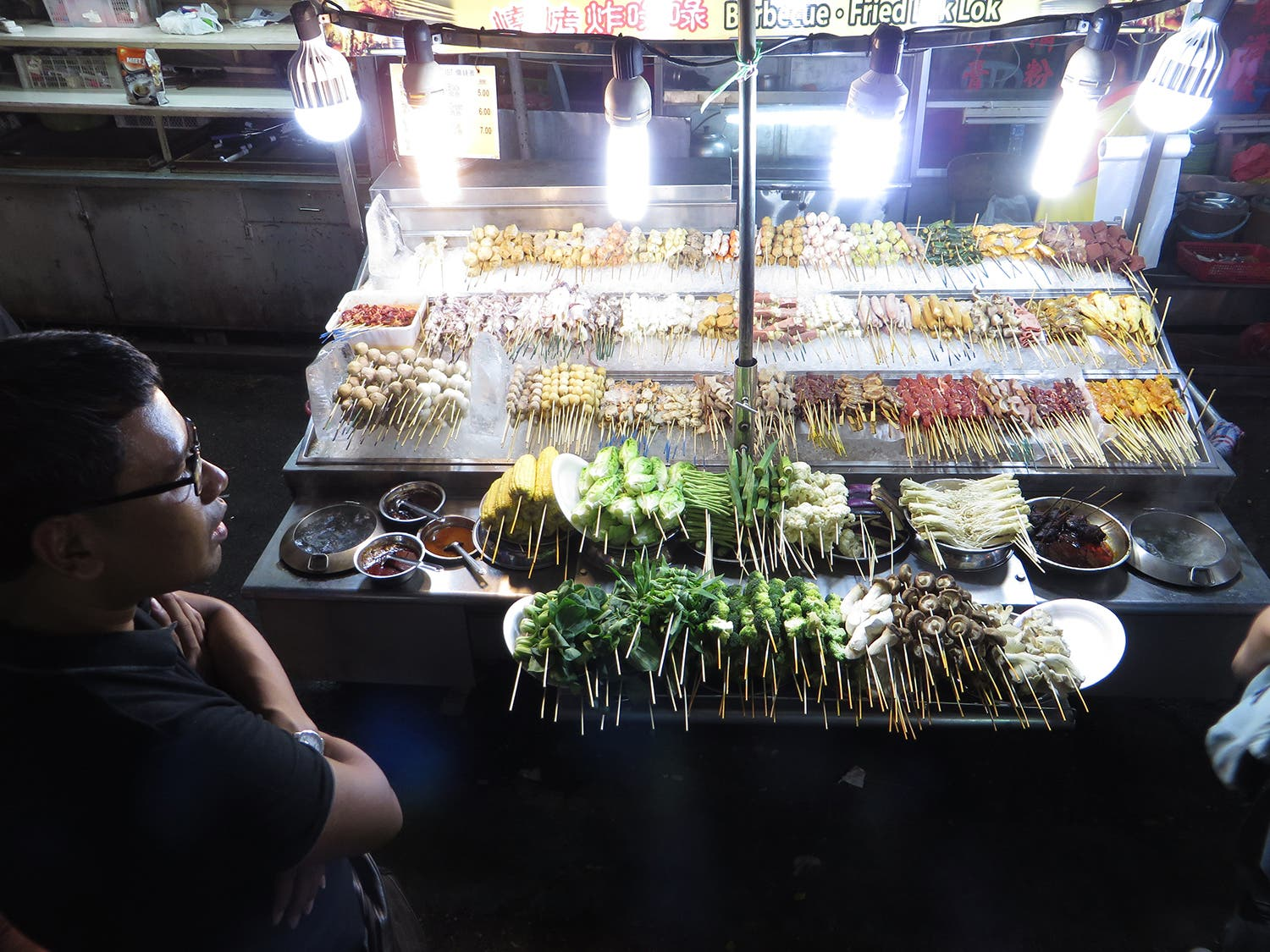 A market stall in a Malaysian street food district (Photo: Peter Harrison)