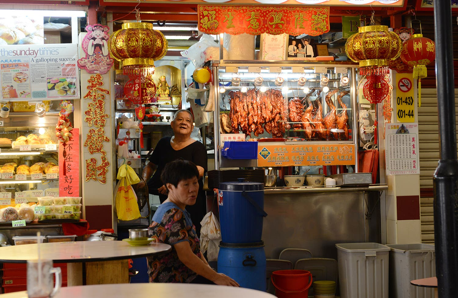 A vendor in a Singapore hawker market selling duck (Photo: Peter Harrison)