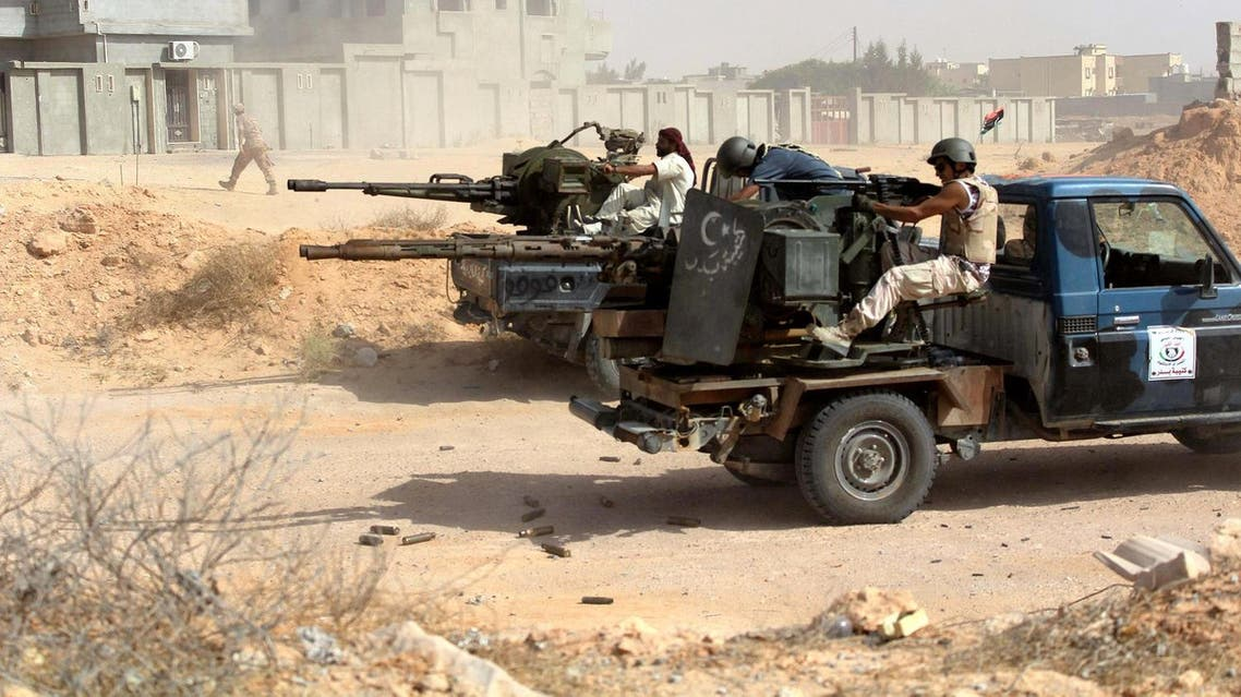 Fighters from forces aligned with Libya's new unity government fire anti-aircraft guns from their vehicles at ISIS positions in Algharbiyat area, Sirte, June 21, 2016 (Photo: Reuters)