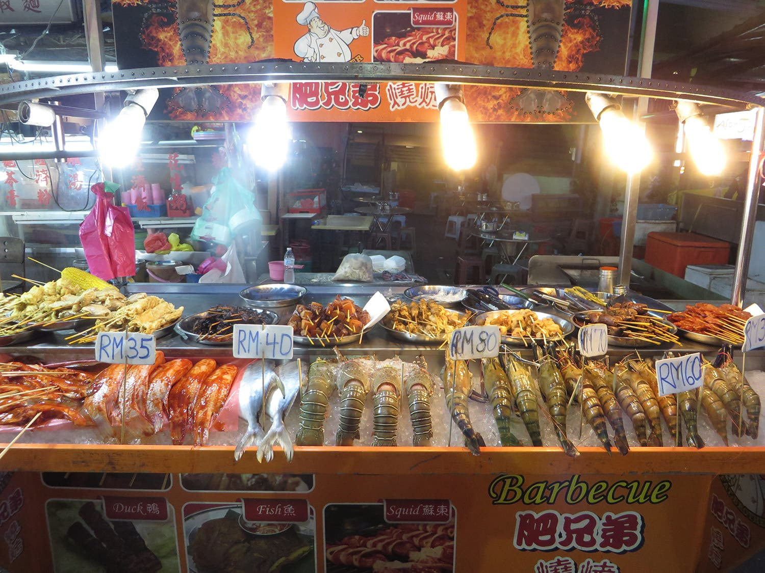 Seafood on display, ready for customers to order and eat in the street (Photo: Peter Harrison)