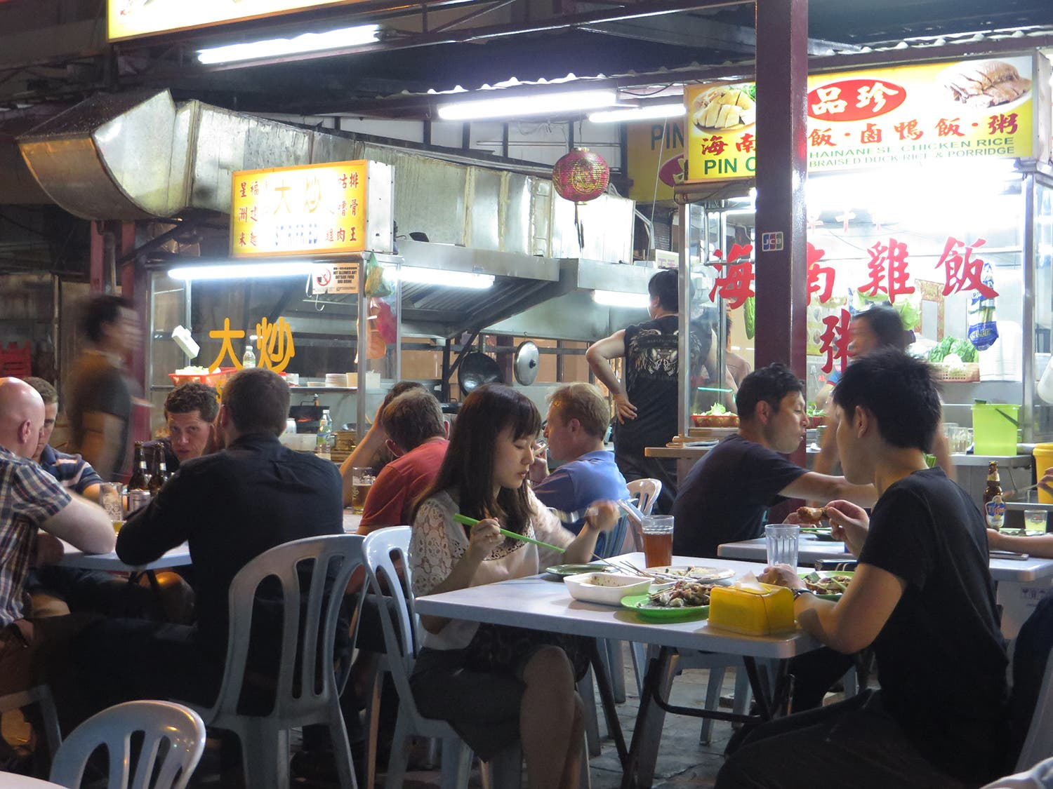 Customers enjoy their food in a Malaysian street (Photo: Peter Harrison)