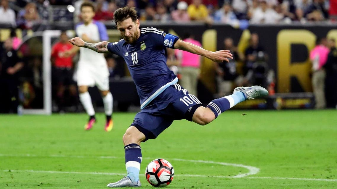 USA; Argentina midfielder Lionel Messi (10) kicks the ball during the second half for an assist against the United States in the semifinals of the 2016 Copa America Centenario soccer tournament at NRG Stadium. Mandatory Credit: Kevin Jairaj-USA TODAY Sports