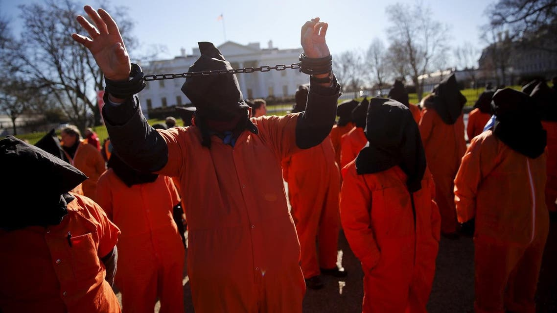 Protesters in orange jumpsuits, including one in plastic shackles, from organizations including Amnesty International USA rally outside the White House to demand the closure of the U.S. prison at Guantanamo Bay. (File photo: Reuters)