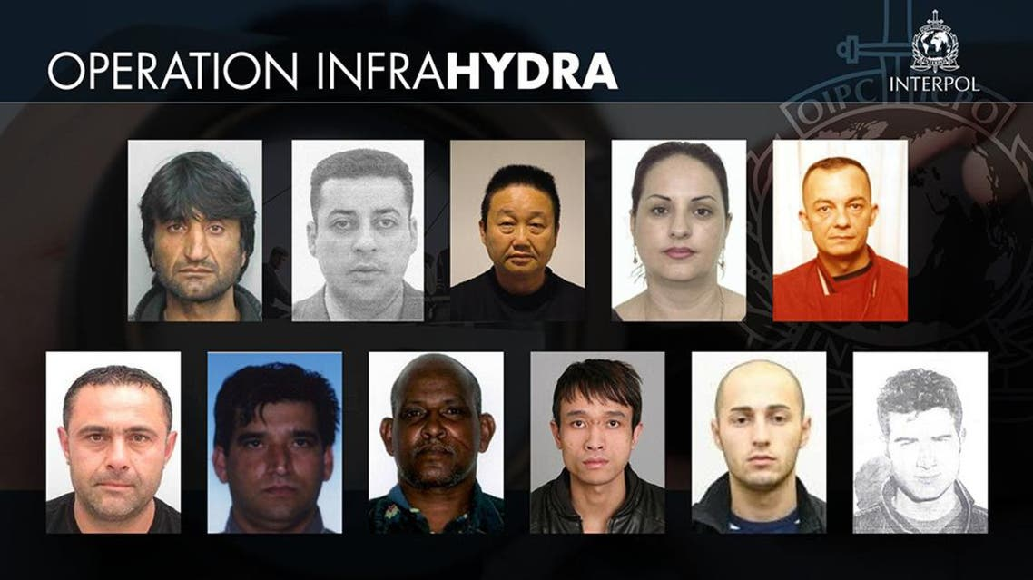This handout picture released by Interpol on June 23, 2016 as part of the Infra Hydra operation shows a warrant of arrest against 11 people sought for being members of an organised crime group, for smuggling or for trafficking. afp