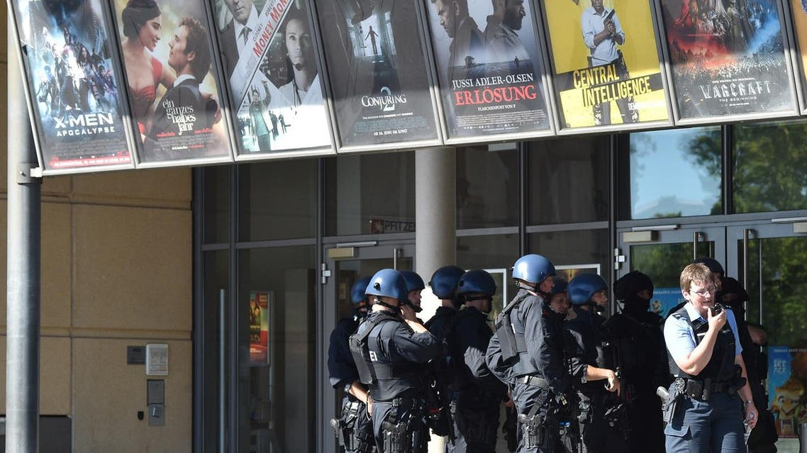 Police officers stand in front of a cinema in Viernheim near Mannheim, southern Germany, Thursday, June 23, 2016. A gunman was shot by police after he took hostages in the complex. (Boris Roessler/dpa via AP)