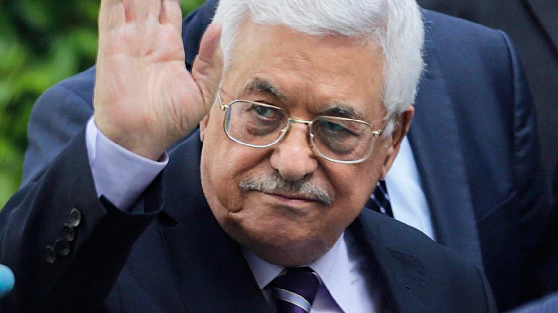 Palestinian President Mahmoud Abbas greets delegations upon his arrival at the Arab League headquarters to attend an emergency Arab League session in Cairo, Egypt, Saturday, May 28, 2016. (AP Photo/Amr Nabil)