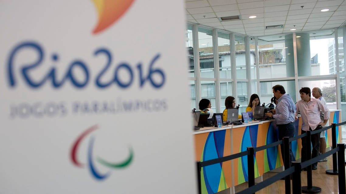 People buy Olympic tickets at a shopping mall in Rio de Janeiro, Brazil, Monday, June 20, 2016. Two ticket offices opened providing tickets for the Rio 2016 Olympic and Paralympic Games. In the coming weeks, more than 30 offices will start operating in Rio as well as in the five cities where Olympic football matches will take place. (AP Photo/Silvia Izquierdo)