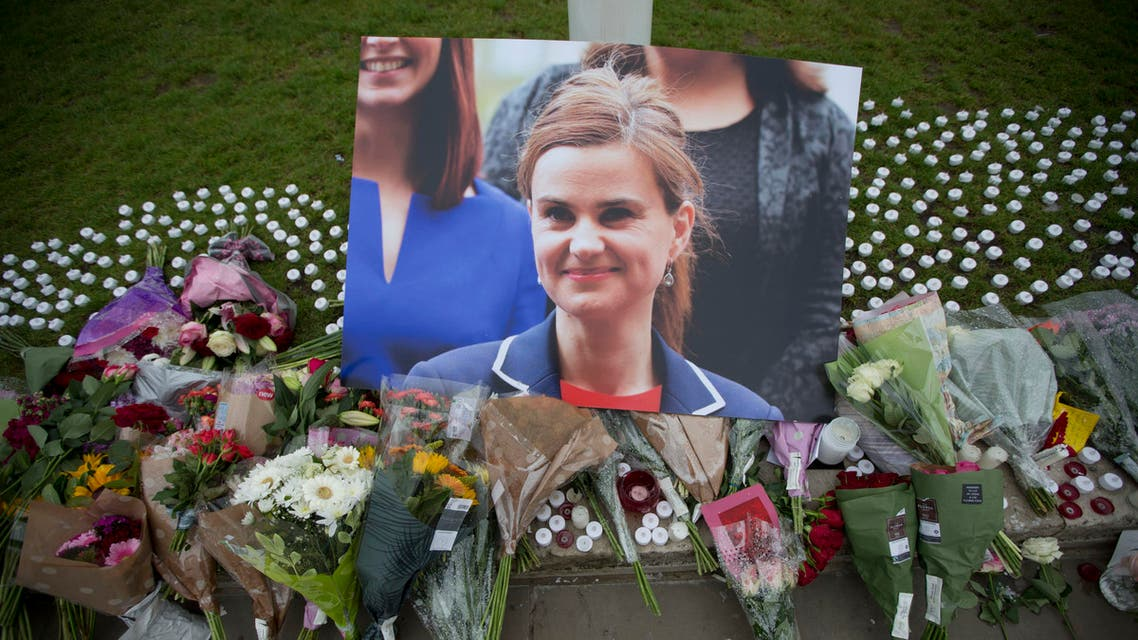 An image and floral tributes for Jo Cox, lay on Parliament Square, outside the House of Parliament in London, Friday, June 17, 2016, after the 41-year-old British Member of Parliament was fatally injured Thursday in northern England.