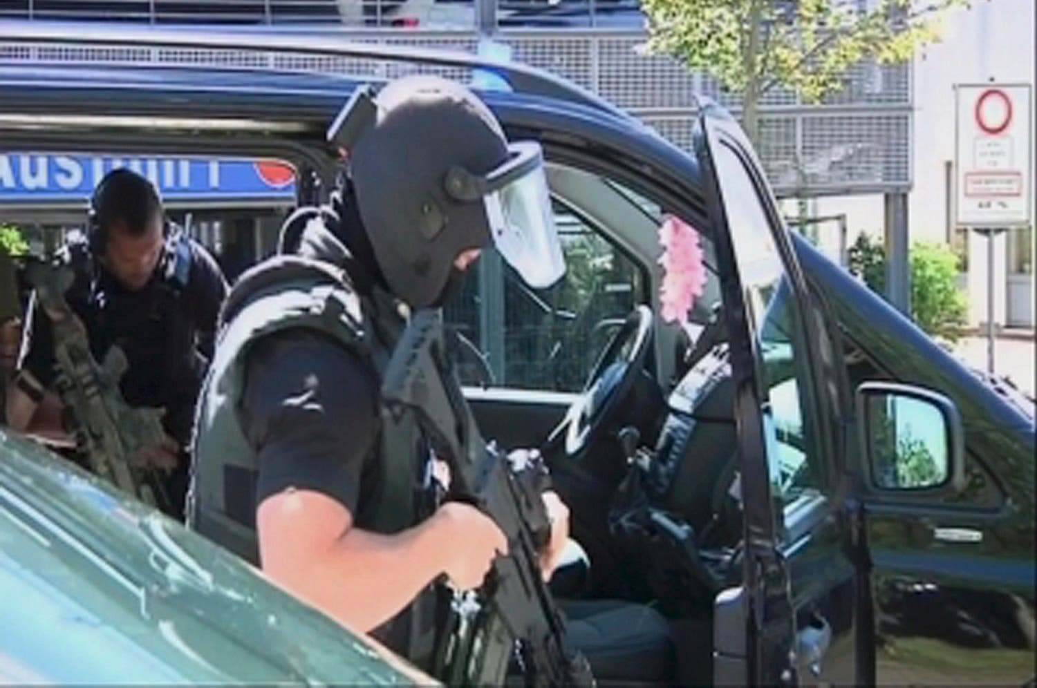 German special police leave their cars in this still image taken from video after the masked man with a gun and ammunition belt opened fire in a cinema complex  (Photo: Reuters)