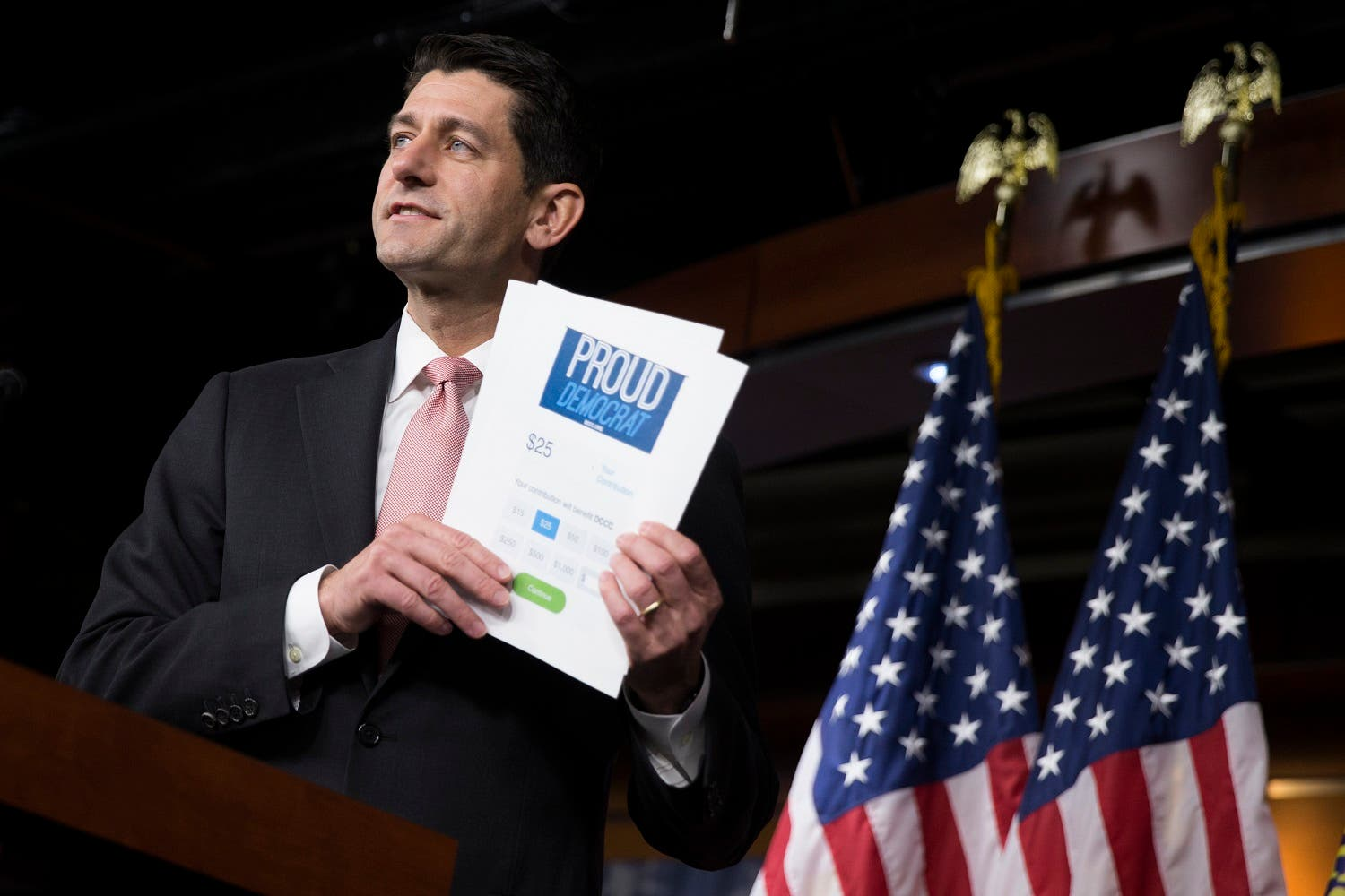 House Speaker Paul Ryan of Wis. holds up a fundraising form for House Democrats as he comments on the ongoing sit-in. (AP)