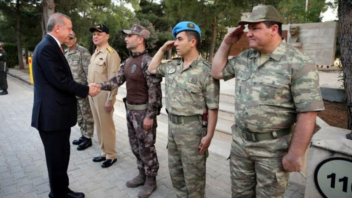 In this photo released by the Turkish Presidential Press Office, Turkish President Recep Tayyip Erdogan greets soldiers as he visits 70th Mechanized Infantry Brigade Command in Mardin, Turkey on June 14, 2016.  (AFP)